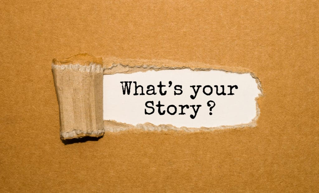 The text What's your story? appearing behind torn brown paper